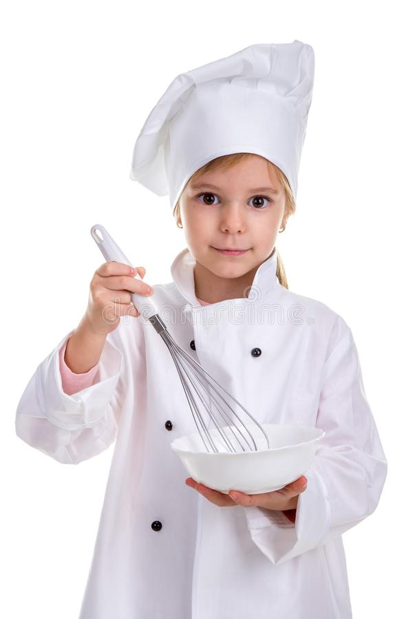 Girl chef white uniform isolated on white background. Holding the white drinking bowl with a whisk. Portrait image.  royalty free stock images