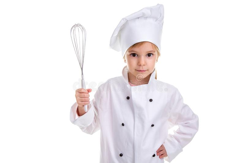 Girl chef white uniform isolated on white background. Holding the whisk in one hand and the other hand on the waist. Landscape image stock image