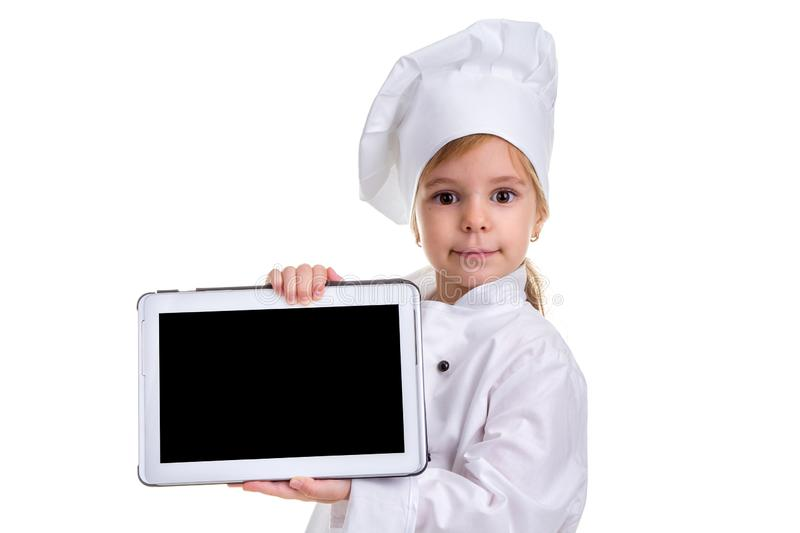 Girl chef white uniform isolated on white background. Showing the empty black ipad screen, looking at the camera royalty free stock photography