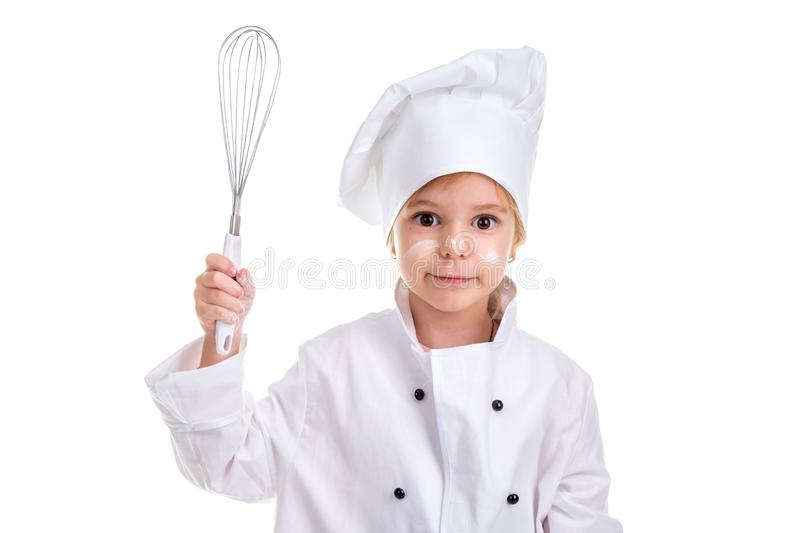 Girl chef white uniform isolated on white background. Floured face. Holding the whisk in one hand. Landscape image royalty free stock photography