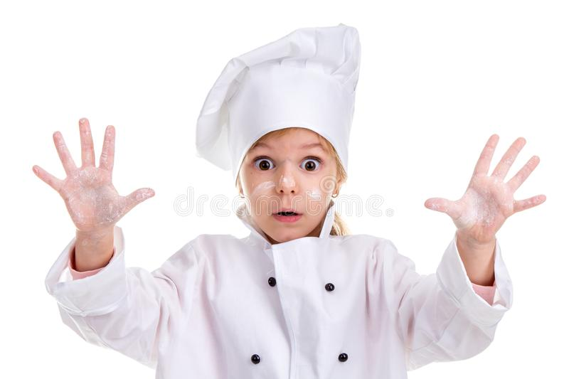 Girl chef white uniform isolated on white background. Floured face and palms up. Looking scared at the camera. Landscape stock photo