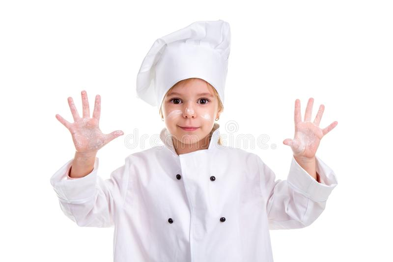 Girl chef white uniform isolated on white background. Floured face and palms up. Looking smiling at the camera stock photo