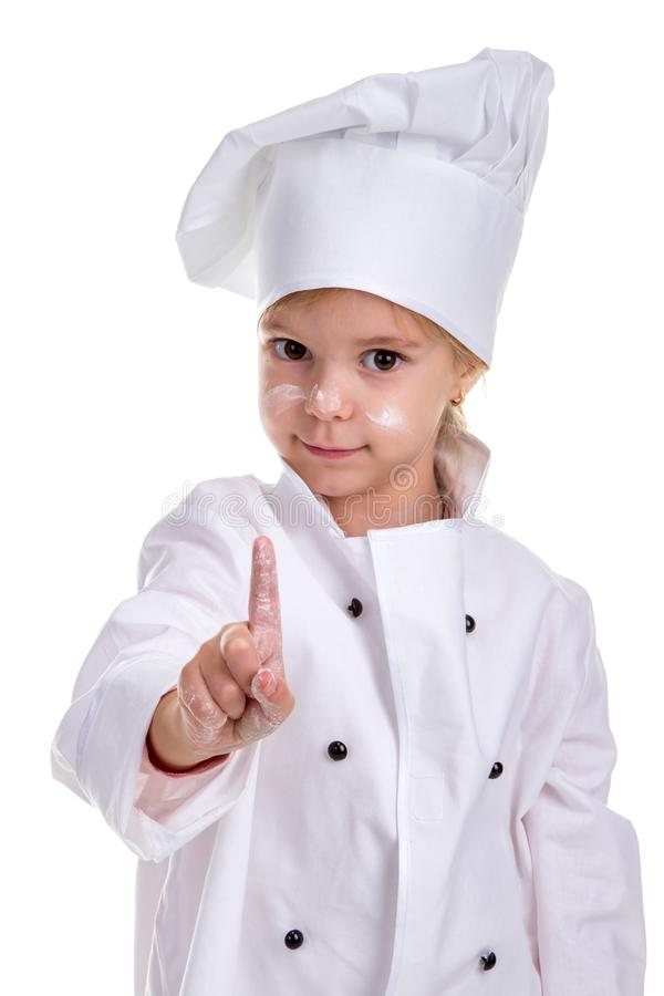 Girl chef white uniform isolated on white background. Looking at the camera. Floured face and pointing finger up stock images