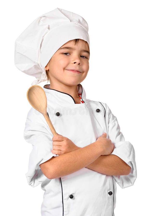 Girl chef with wooden spoon royalty free stock image