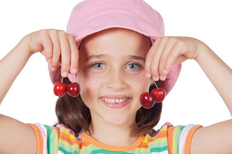 Girl with cherries stock image