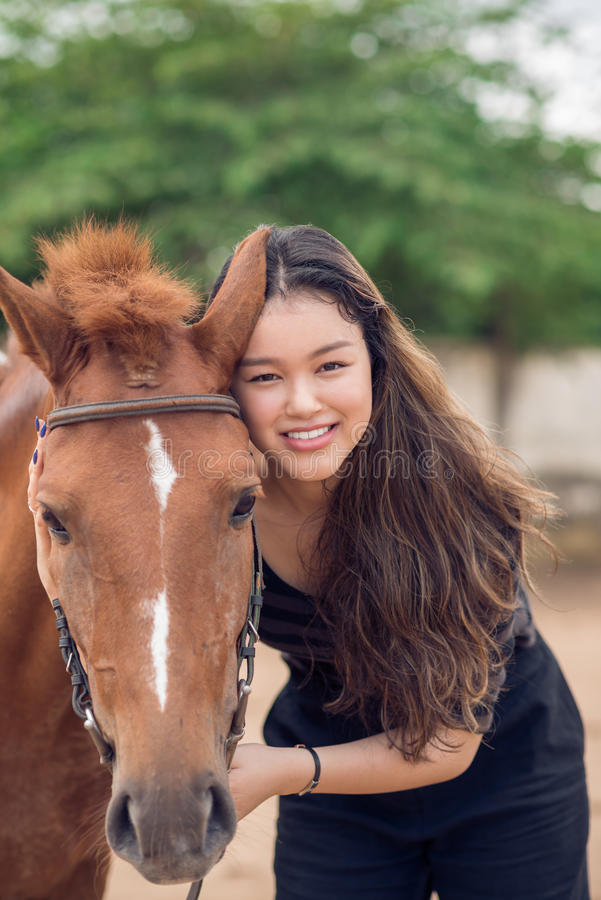 Girl with chestnut pony stock photography