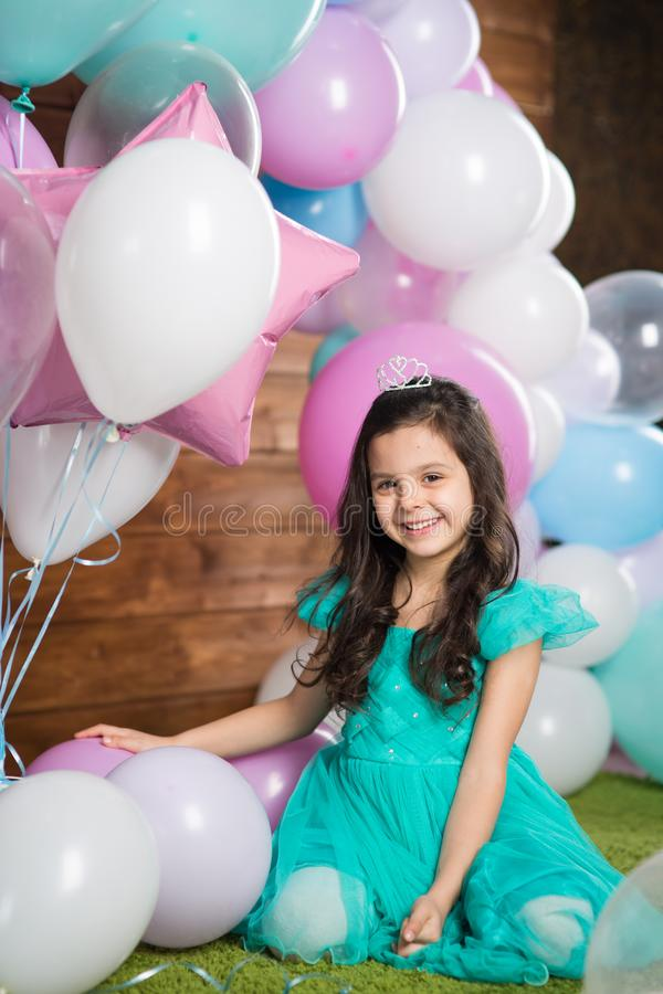 Girl child with balloons stock photo
