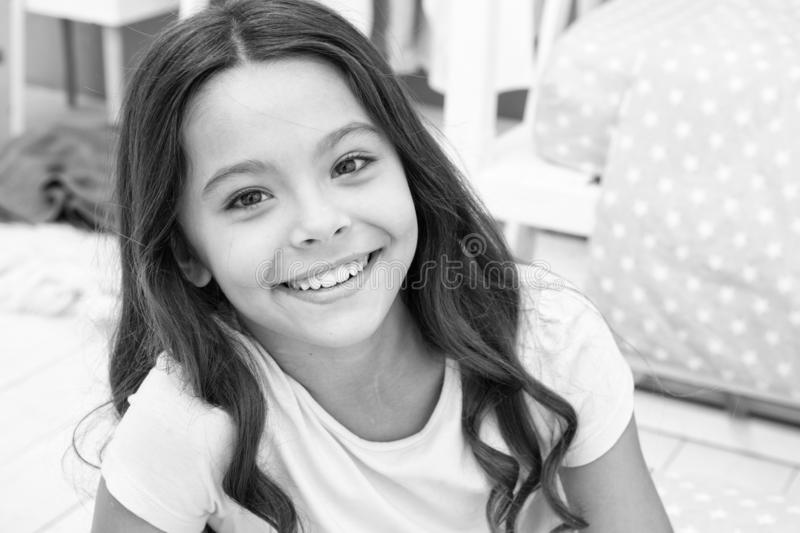 Girl child in bedroom. Kid smiling prepare go to bed. Pleasant time relax cozy bedroom. Girl kid long hair cute pajamas. Relaxing before sleep. Time to sleep or royalty free stock images
