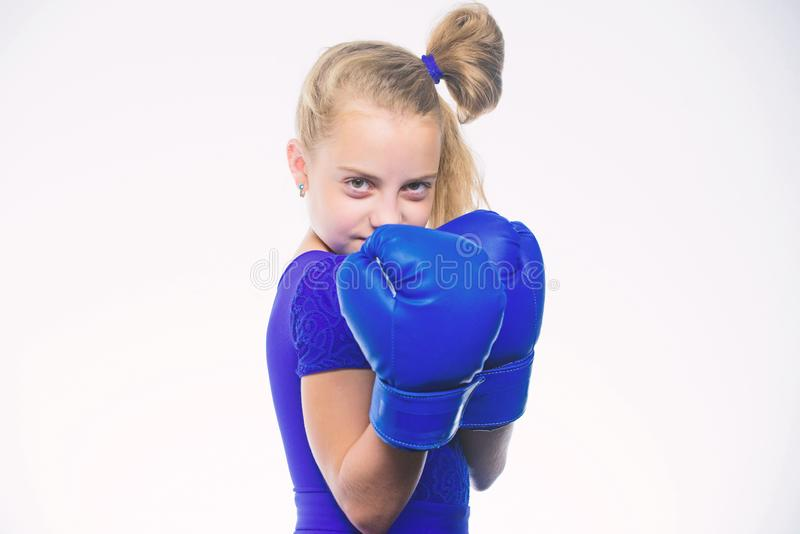 Girl child with blue gloves posing on white background. Sport upbringing. Upbringing for leadership and winner. Strong royalty free stock photo