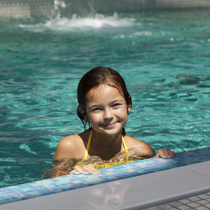 Girl Child In Blue Water Of The Swimming Pool Stock Image Image 25887259