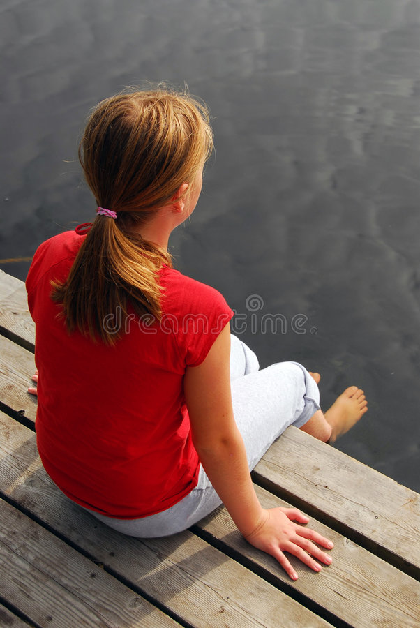 Girl child dock stock photography
