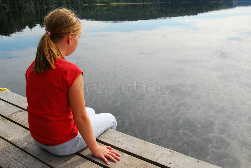 Girl child dock royalty free stock photo