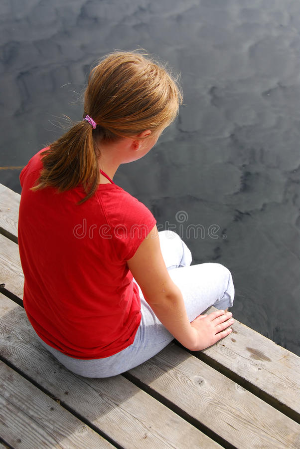 Girl child dock stock image