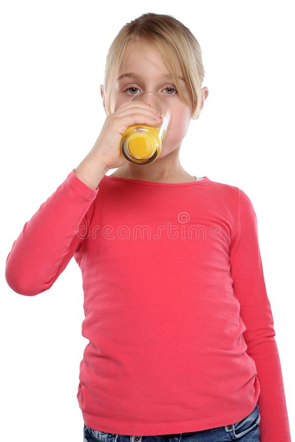 Girl child drinking orange juice healthy eating portrait format. Isolated on a white background stock images