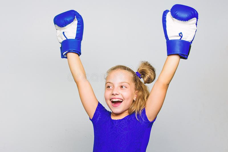 Girl child happy winner with boxing gloves posing on grey background. Feminist movement. She feels as winner. Upbringing. For leadership and winner. Strong stock photography