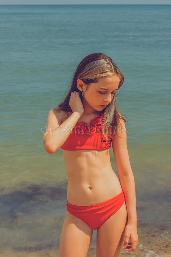 Free Girl Child In Swimsuit Near The Sea, The Concept Of Rest And Vacation . Teenage Girl Near The Sea Stock Photography - 202401812