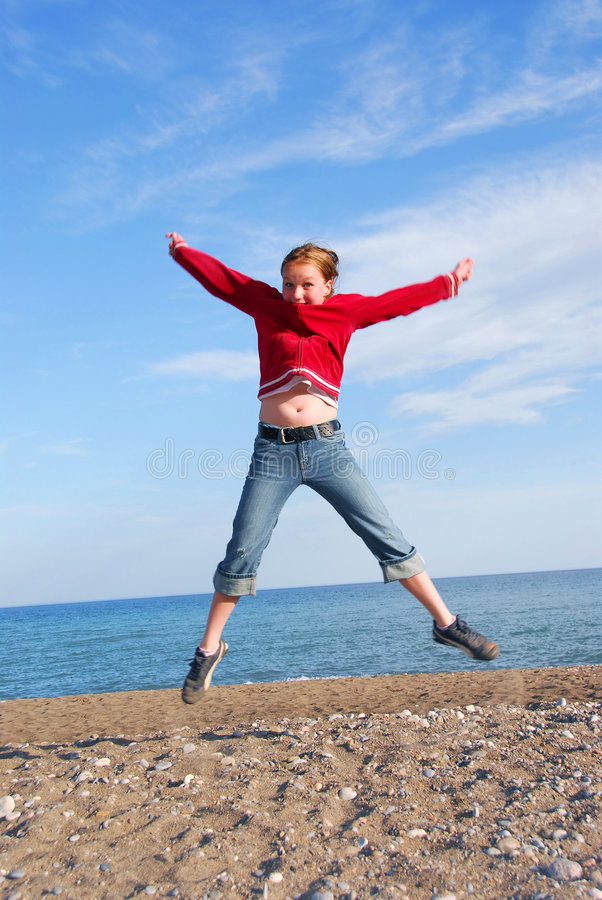 Girl child jumping royalty free stock image