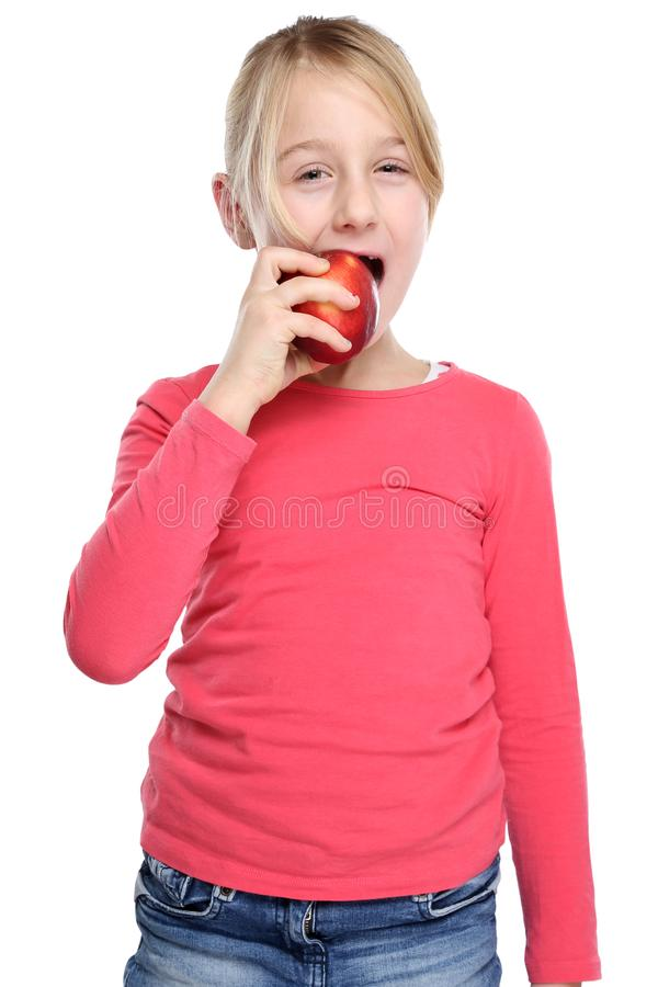Girl child kid eating apple fruit autumn fall healthy isolated o. N a white background stock images