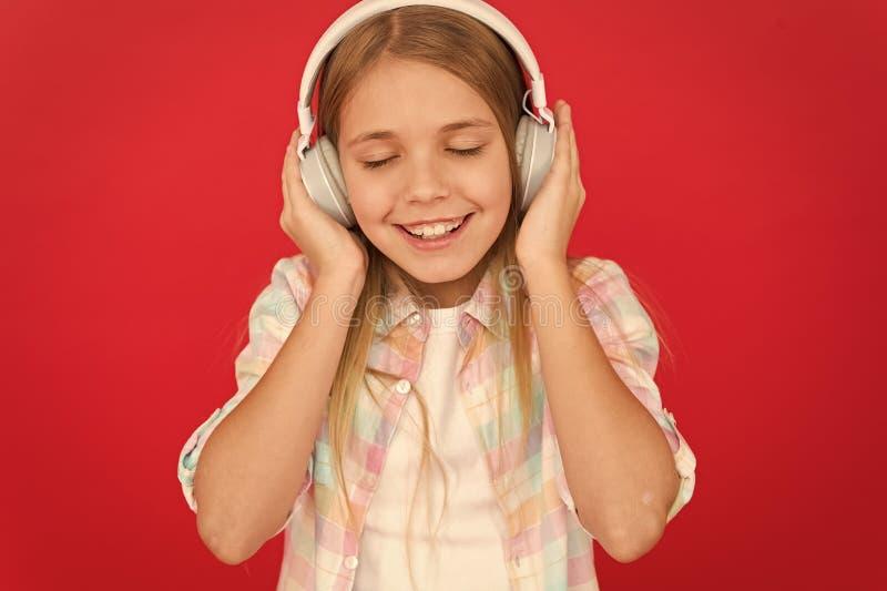 Girl child listen music modern headphones. Get music account subscription. Enjoy music concept. Music always with me. Little girl listen song headphones stock images