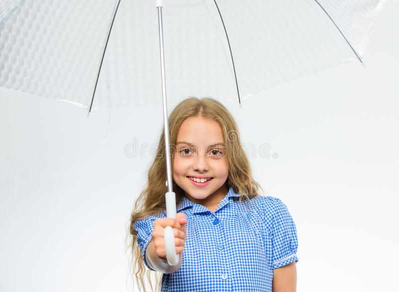 Girl child ready meet fall weather with transparent umbrella white background. Enjoy rainy days with umbrella accessory royalty free stock image