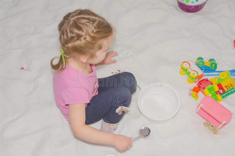 The girl child in the salt room plays, the treatment of the common cold stock image