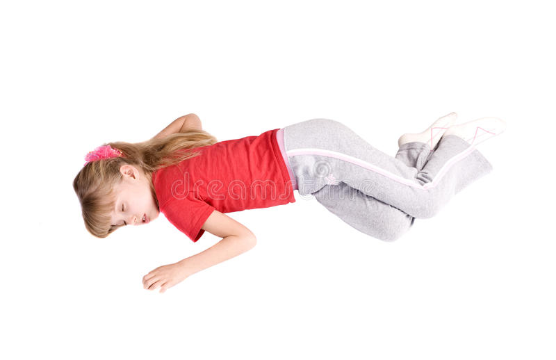 Girl child sleep on floor. stock photo