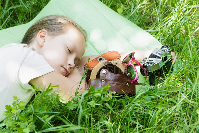 The girl child is sleeping resting outdoors. stock photo
