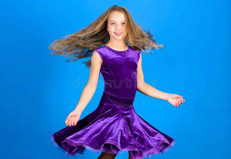 Girl child wear velvet violet dress. Kid fashionable dress looks adorable. Ballroom dancewear fashion concept. Kid. Dancer satisfied with concert outfit royalty free stock photos