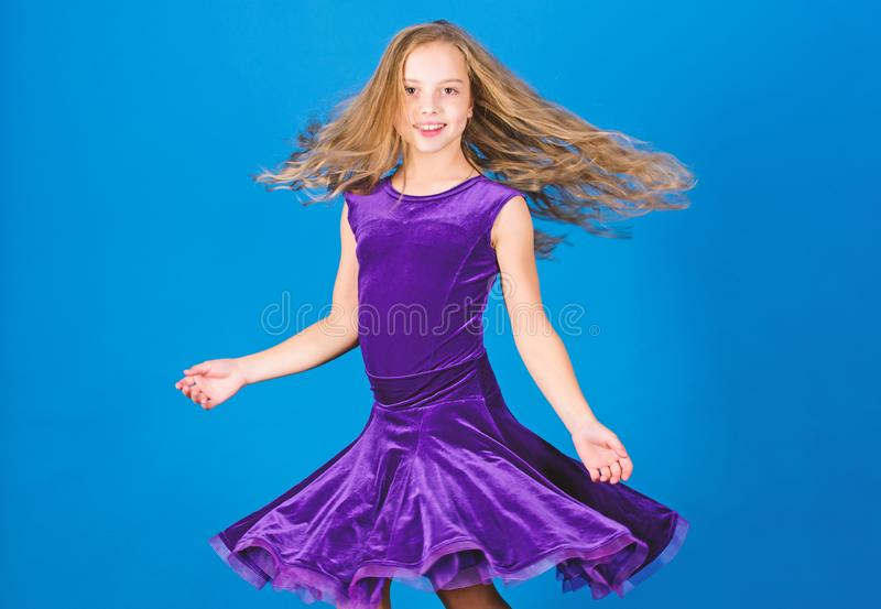Girl child wear velvet violet dress. Kid fashionable dress looks adorable. Ballroom dancewear fashion concept. Kid. Dancer satisfied with concert outfit royalty free stock images