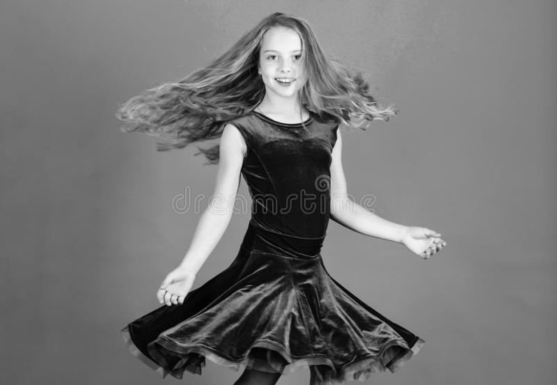 Girl child wear velvet violet dress. Kid fashionable dress looks adorable. Ballroom dancewear fashion concept. Kid royalty free stock image