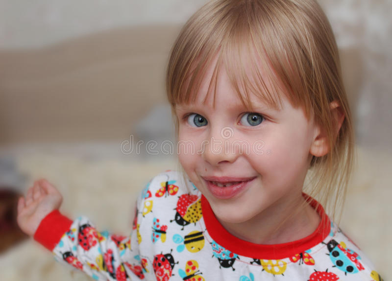 Girl children on bed in pajamas. stock photography