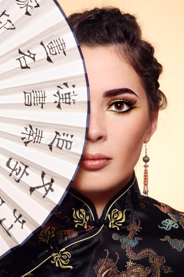 Download Girl with Chinese fan stock photo. Image of hieroglyph - 17254382