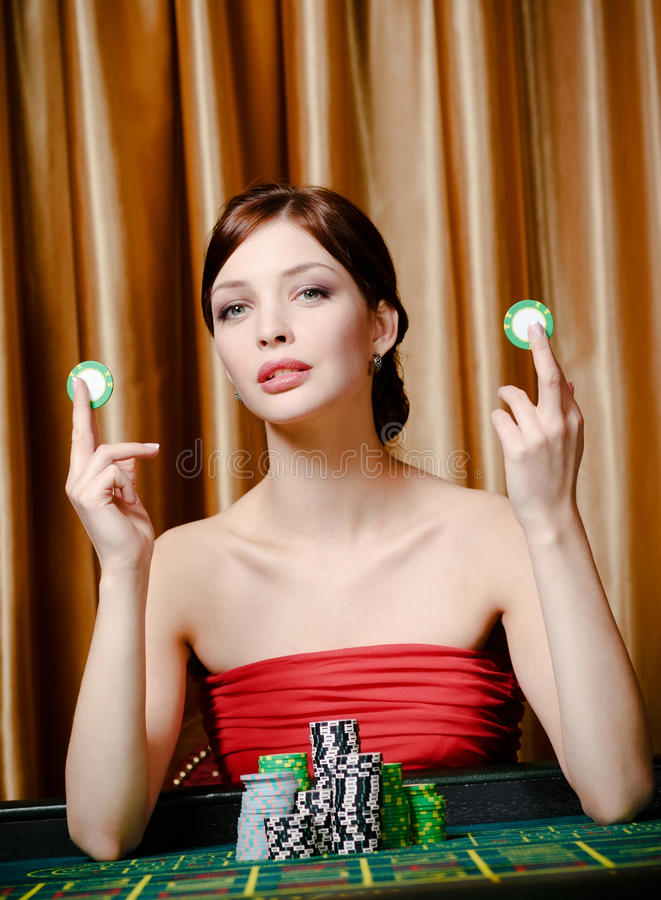 Girl with chips at the roulette table royalty free stock photos
