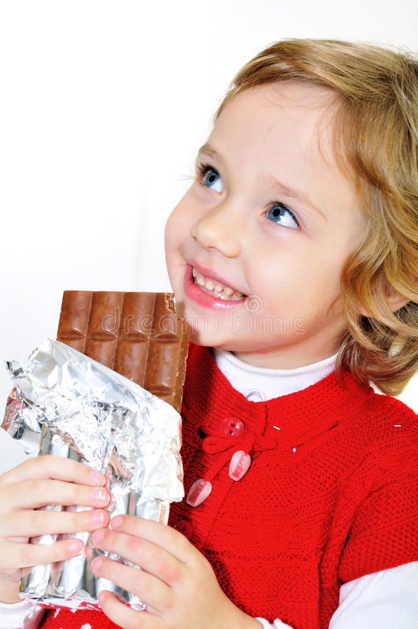 Girl And Chocolate Royalty Free Stock Photos