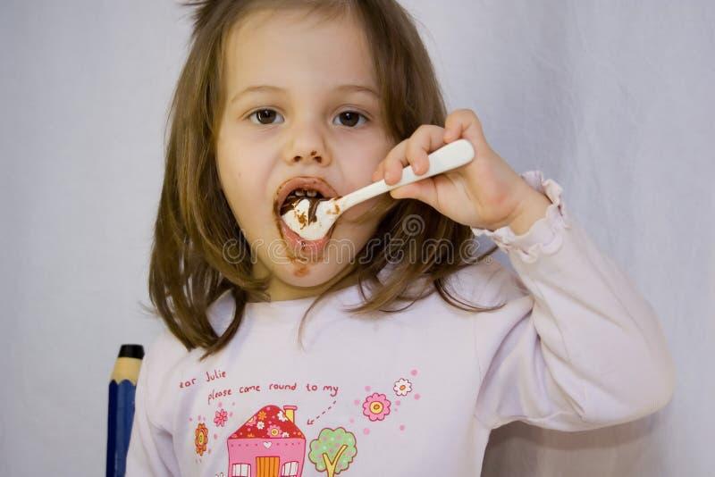 Girl and the chocolate stock image