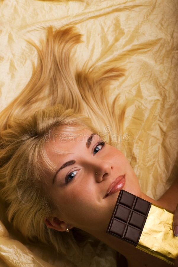 Girl With A Chocolate Royalty Free Stock Photography