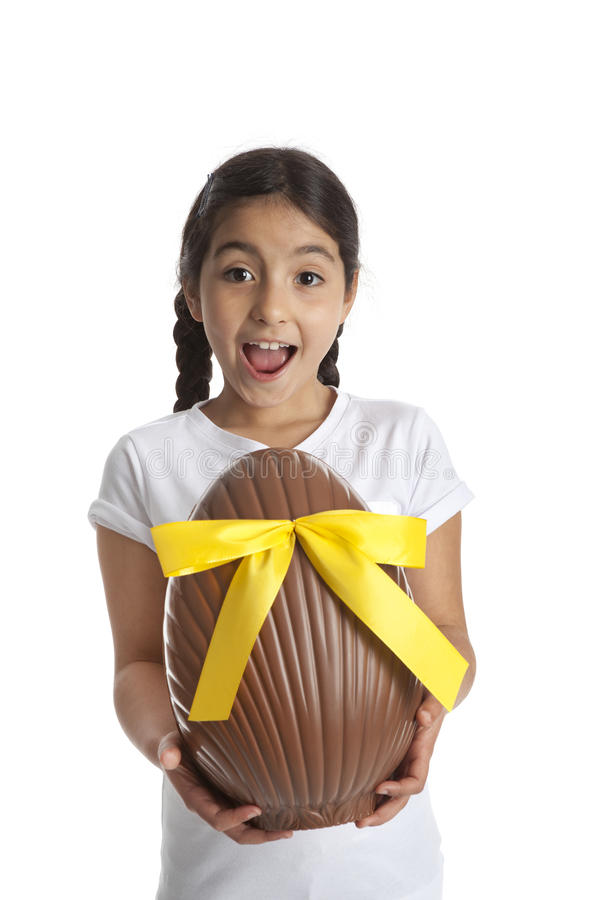 Girl with chocolate easter egg stock images