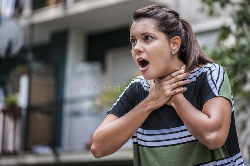 Girl is choking royalty free stock images