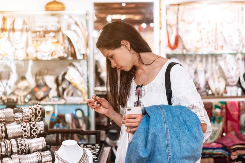 Girl chooses jewelry in a jewelry store. stock photos