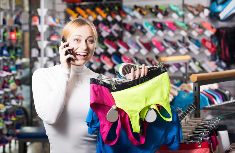 Girl choosing a sport bra stock photography