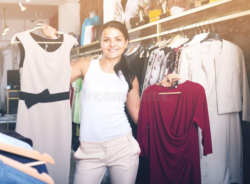 Download Girl Chousing Dress Stock Photo - Image: 83701768