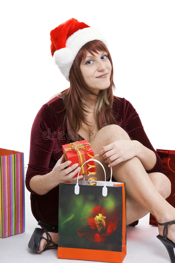 Download The Girl In A Christmas Cap With Purchases Stock Image - Image: 12260059