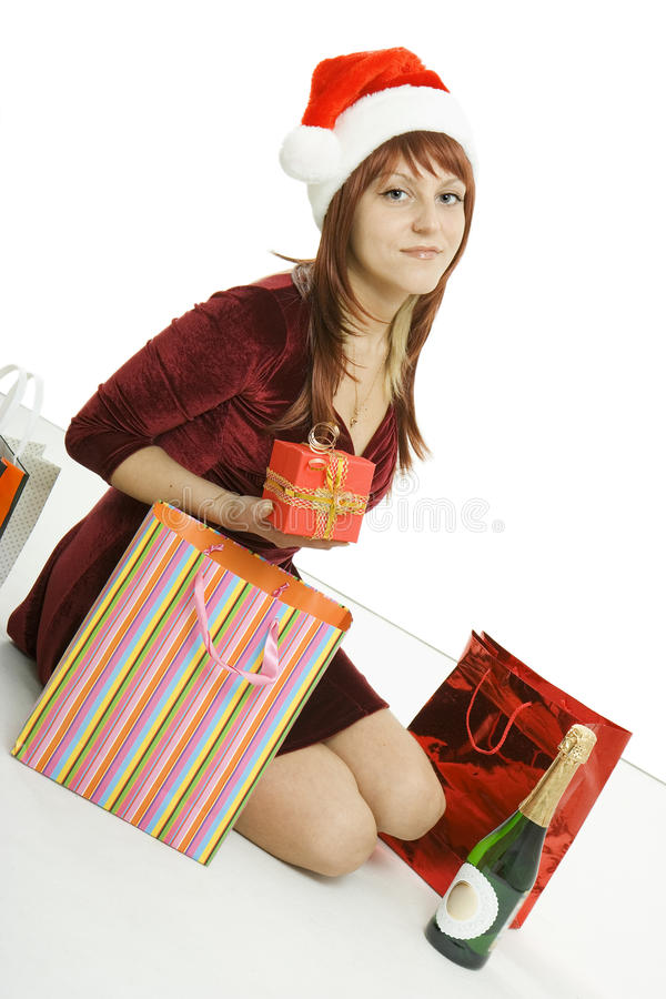 Download The Girl In A Christmas Cap With Purchases Stock Image - Image of night, black: 12268291