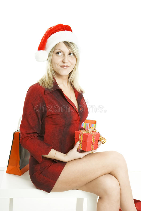 Download The Girl In A Christmas Cap With Purchases Stock Photo - Image of fashion, model: 12290950