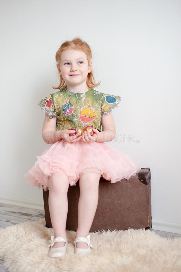 A girl in a Christmas dress stock photos