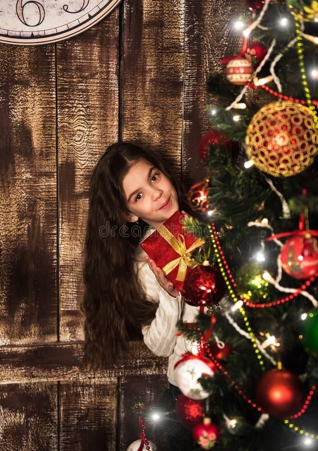 Girl with christmas gift box. Happy little smiling girl with christmas gift box stock image