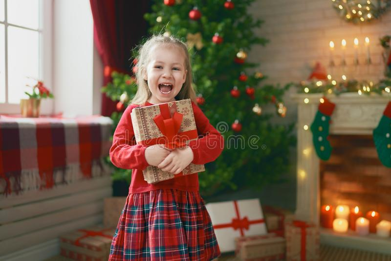 Girl with Christmas gift stock image