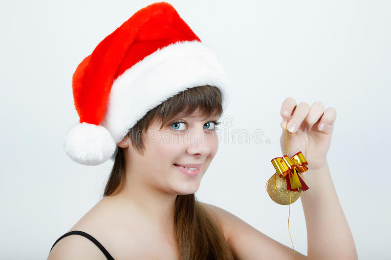 Download Girl In A Christmas Hat With Christmas Decorations Stock Image - Image: 26061713