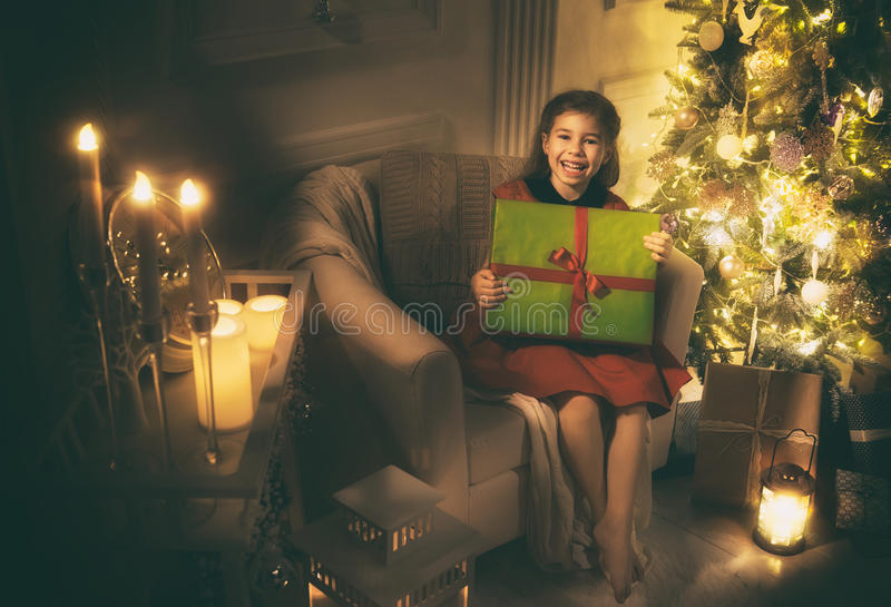 Girl with Christmas present royalty free stock images