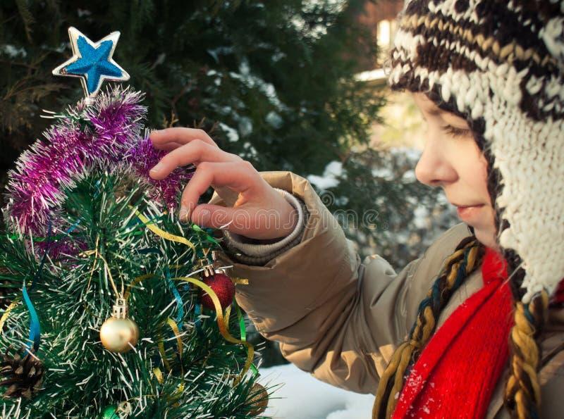 Girl with Christmas tree royalty free stock image
